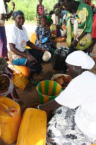 Diapaga - Sorghum beer (Dolo) being served at a market in Tapoa djerma, Burkina Faso