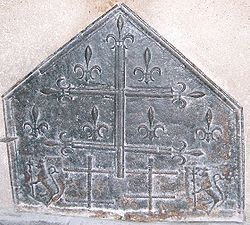 Five-sided piece of metal, decorated with crosses and fleurs-de-lis.