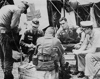 Dominican Civil War - U.S. Medical Service officers conferring near Santo Domingo in early May 1965.