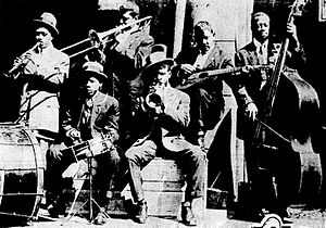 "The Eagle Band - ""The Eagle Band"",  South Rampart Street, New Orleans, February 1916. Edmond Hall, clarinet; Frankie Duson, trombone; Chinee Foster, drums; Buddie Petit, cornet; Lorenzo Staultz, guitar; Dandy Lewis, string bass."