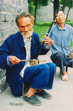 Bowed string instrument - Two performers playing the Erhu, sometimes known as the Chinese fiddle.