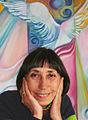 Evelina Coelho a frente de um quadro.jpg