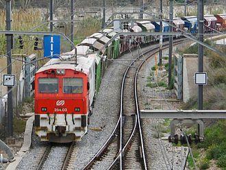 Ferrocarrils de la Generalitat de Catalunya - FGC locomotive 254.03 hauling freight cars near Sant Boi