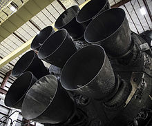 Falcon 9 first stage in hangar; upgraded Merlin engines close-up (24175842635).jpg