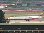 Far Eastern Air Transport MD-82 Moving in Songshan Airport Apron 20121101.jpg