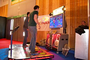 Rhythm game -  Players using a dance mat to play Dance Dance Revolution, one of the most successful rhythm games