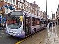 First Leeds bus parked on Kirkgate, Leeds (19th July 2014).jpg