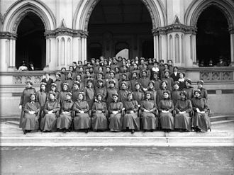 New Zealand Army Nursing Service - Group portrait of the first 69 nurses and 11 staff to leave for World War I. Taken on the steps of the General Assembly Library, Wellington, by an unidentified photographer for The Press newspaper of Christchurch.