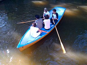 Five guys in a canoe (from above).jpg