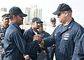 Flickr - Official U.S. Navy Imagery - A Bahraini fisherman shakes hands with a Sailor..jpg