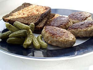 Danish cuisine - Frikadeller (meat balls) with rugbrød (rye bread) and pickled gherkins