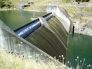 Diversion dam - The Faraday Diversion Dam, Clackamas River. This dam slows a normally fast and shallow river for partial diversion to a hydroelectric dam. The diversion tunnel opening can be seen in the upper left.