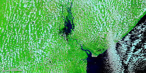 Pungwe River - The Pungwe River flooding as seen from NASA MODIS satellite in 2010.