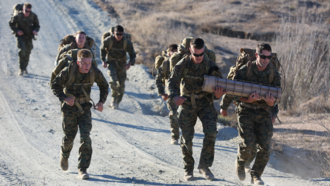 1st Reconnaissance Battalion - Marines with Force Company, 1st Reconnaissance Battalion, 1st Marine Division hike with 50-pound packs and carry a 60-pound container full of sand during a physical training exercise on Nov. 7, 2014