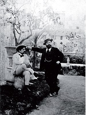 Mario Rutelli - Mario Rutelli(right) with photographer Vincenzo Galdi(left) outside the sculptor's studio in via Margutta. The photo created with the self-timer in 1901.