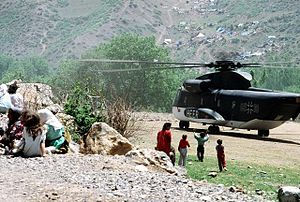 Operation Provide Comfort - Kurdish refugee children run toward a CH-53G helicopter of the German Army during Operation Provide Comfort