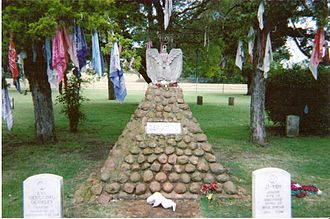 Fort Sill - Geronimo's grave at Fort Sill with Apache prayer clothes in trees.