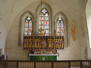 Lye Church - Interior view of the choir with the altarpiece and some of the famous stained glass windows