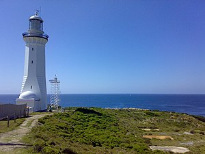 Green Cape Lighthouse - Green Cape Light. The current light is the skeletal tower to the right of the original tower.