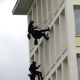 GSG 9 - GSG 9 operators rappel on a building of the German Bundeskriminalamt.