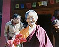 HH Kalu Rinpoche offered red carnations, and students, Tashi, Steve D., Sakya Tegchen Choling, Wallingford neighborhood, Seattle, Washington, USA, 1978.jpg