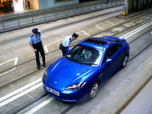 HK Des Voeux Road C Bus Lane Motor Car Lost in Tram Lane n Police Uniform in Summer 2008 1 a.jpg