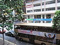 HK Wan Chai 灣仔 Tai Yau Plaza view Bus body ads 麥潤壽 Sir Never GiveUp 同學會 DBC Radio Sunday.JPG