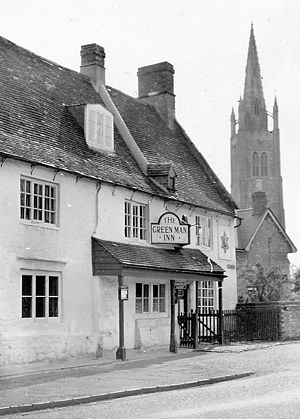 Hanslope - The Green Man Inn public house and the steeple of St James the Great in the 1950s