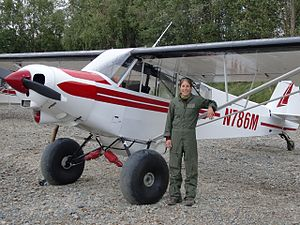 United States Fish and Wildlife Service - Arctic Refuge Law Enforcement Officer Heather Bartlett stands alongside her Super Cub, 2009