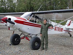 United States Fish and Wildlife Service - Arctic Refuge Law Enforcement Officer Heather Bartlett stands alongside her Super Cub, 2009