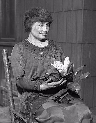 Helen Keller - Helen Keller holding a magnolia, ca. 1920