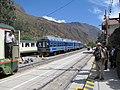 Hiram Bingham train by Perurail to Machu Picchu and Sacred Valley Peru - Ollantaytambo train station (4876177104).jpg