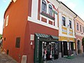Historic house (yellow), an old-fashioned restaurant. Listed ID 7341 Copf style, circa 1890. To the left an another historic Baroque house with shop. Monument ID 7352 around 1750 - Szentendre, Dumtsa St 2, Fő square 1.JPG