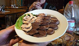 Culture of Kazakhstan - A platter of horse meat served traditionally as an appetizer.