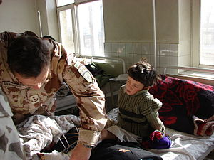 Chaghcharan - A Lithuanian medic visits a patient in Chaghcharan hospital.