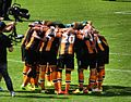 Hull City group hug.jpg