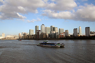 Thames Clippers - Hurricane Clipper approaching Greenland Pier with Canary Wharf in the background