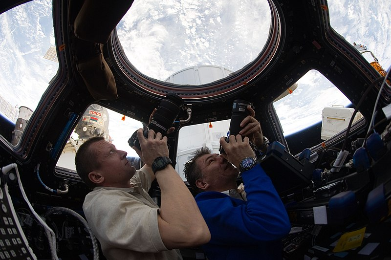 ISS-27 Dmitri Kondratyev and Paolo Nespoli photograph the Earth through the Cupola.jpg