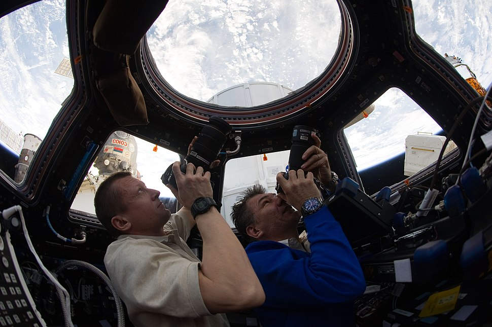 ISS-27 Dmitri Kondratyev and Paolo Nespoli photograph the Earth through the Cupola