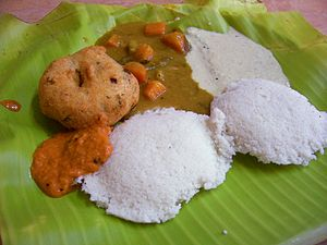 Tamil cuisine - Idly with Medu vada (Ulundhu Vadai) with Chutney, Sambhar served on banana leaf