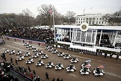 The Inaugural Parade on Pennsylvania Avenue passes the Presidential reviewing stand in front of the White House.