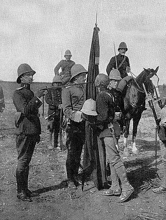 New Imperialism - Indigenous African soldier pledging alliance to the Spanish flag. European armies would regularly enlist native men to garrison their own land.