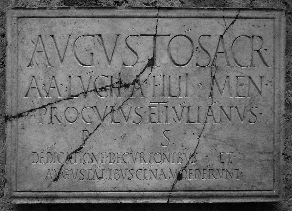Inscription displaying apices (from the shrine of the Augustales at Herculaneum)
