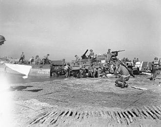 Operation Avalanche - Artillery being landed during the invasion of mainland Italy at Salerno, September 1943.