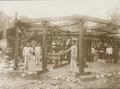 KITLV - 158792 - Kurkdjian - Sourabaia-Java - Gold mining in the mining company Totok Sulawesi at Monsal in the Minahasa - circa 1900.tiff
