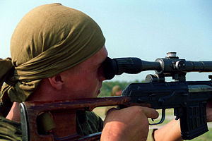 Counter-sniper tactics - A Kazakh soldier using a sniper rifle in a counter-sniping exercise.