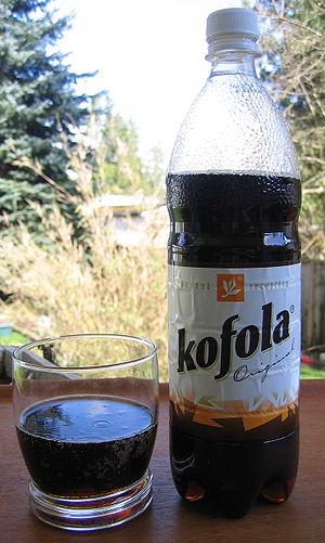 Kofola - A glass and a bottle of Kofola