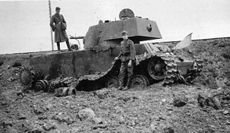 5th Guards Motor Rifle Division - A destroyed KV-1 is inspected by German Troops in Russia in 1941