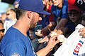 Kris Bryant signing autographs during his rehab assignment against Omaha (30447718168).jpg