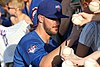 Kris Bryant signing autographs during his rehab assignment against Omaha (44315235011).jpg